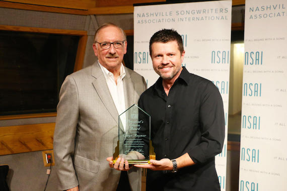 Elwyn Raymer (President of CMPA) accepting the NSAI President's Choice Award; NSAI President Lee Thomas Miller