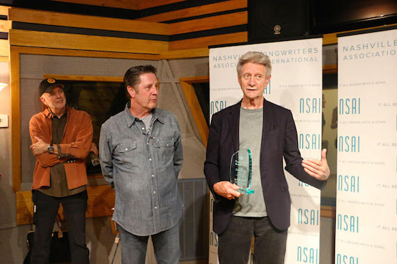 Ralph Murphy (VP of ASCAP Nashville) accepting The Maggie Cavender Award; NSAI Executive Director Bart Herbison, NSAI Board Member and songwriter, Byron Hill