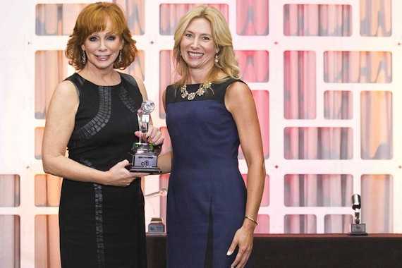 Reba McEntire accepts her Women In Music City Award from Nashville Business Journal Publisher Kate Herman.
