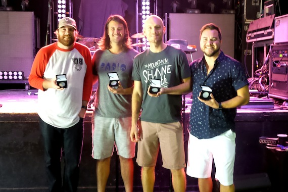"Eli Young Band accepts their MusicRow No. 1 Challenge Coin for ""Dust."""