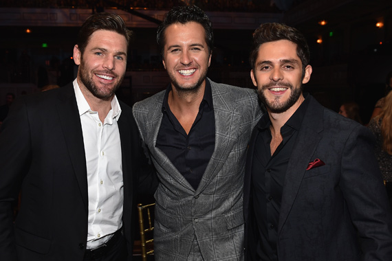 Pictured (L-R): Mike Fisher, Luke Bryan, Thomas Rhett. Photo: John Shearer/Getty Images for CMT