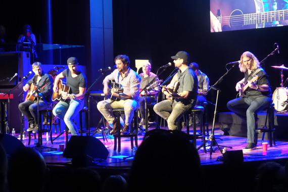 Luke Bryan performs with songwriters Ashley Gorley, Dallas Davidson and Chris DeStefano.