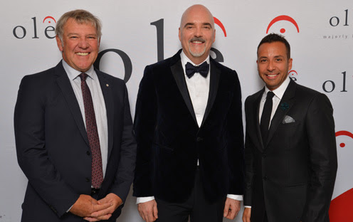 (L-R) Alex Lifeson of the rock band Rush; ole CEO and Chairman, Robert J. Ott; and Howie Dorough of the pop music band Backstreet Boys, celebrate 12 consecutive years of ole's growth and success at the launch of the company's new headquarters in Bremner Tower, located in Toronto's Southcore District