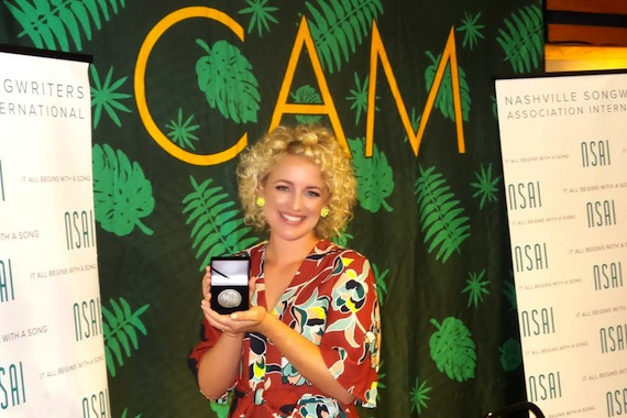 "Cam accepts her No. 1 MusicRow Challenge Coin for ""Burning House."""
