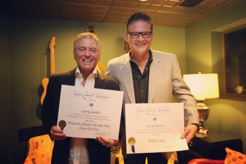 Pictured (L-R): Larry Gatlin, BMI's Perry Howard. Photo: Moments By Moser