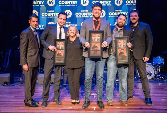 "ASCAP VP of Membership Michael Martin (l) congratulates (L-R) Warner Chappell's Travis Carter, Liz Rose Music's Liz Rose, songwriter Corey Crowder, Liz Rose Music's Scott Ponce, and RCA Records Nashville recording artist Chris Young on their ASCAP Top Five Song, ""I'm Comin' Over."" Photo: Ed Rode"