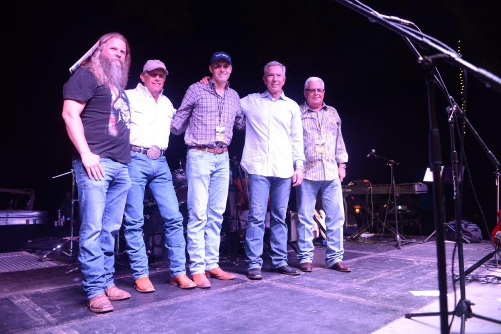 Pictured (L-R): Jamey Johnson, George Strait, Jordan Spieth, Tom Cusick and auctioneer Kerry Fisher