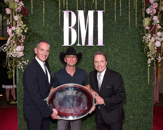 BMI President & CEO MikeO'Neill and BMI Vice President, Writer/Publisher Relations Jody Williams posewith 2016 President's Award recipient Kenny Chesney. Pictured L to R: O'Neill,Chesney, Williams.