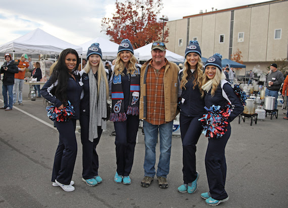 Tracy Lawrence Stands with Titans Cheerleaders at 11th Annual Mission: Possible Turkey Fry. Photo: Jon-Paul Bruno