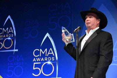 """Five-time CMA Entertainer of the Year Garth Brooks shares remarks Wednesday during a press conference following """"The 50th Annual CMA Awards."""" Photo: ABC/Brett Oronzio"""