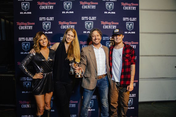 Rolling Stone Country's Beville Dunkerley and Joseph Hudak (center) receive the 2016 CMA Media Achievement Award from Country artists Cassadee Pope (l) and Tucker Beathard. Photo: Joseph Llanes