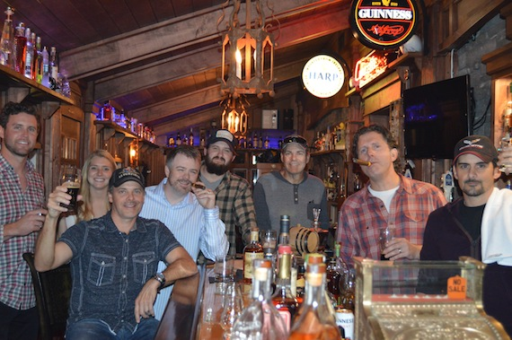 "Ryan Beuschel (WC), Christina Wiltshire (SG), Kelley Lovelace, Ben Vaughn (WC), Jake Gear (SG), Mike Owens (SG), Chris DuBois (SG), Brad Paisley (SG) in Paisley's home bar, ""Ye Olde Potion Room Pub."""