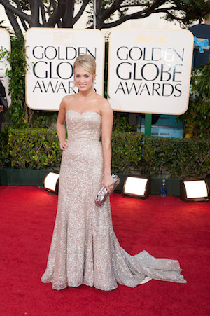 """Nominated for BEST ORIGINAL SONG MOTION PICTURE for """"There's A Place For Us"""" for Chronicles Of Narnia: The Voyage Of The Dawn Treader, Carrie Underwood attends the 68th Annual Golden Globe Awards at the Beverly Hilton in Beverly Hills, CA on Sunday, January 16, 2011. ++ FASHION TAGS ++ Carrie Underwood: Badgley Mischka"""