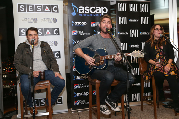 Pictured (L-R): Justin Ebach (SESAC), Brett Young (ASCAP), Kelly Archer (BMI). Photo: Terry Wyatt